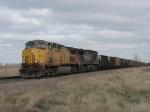 UP 6520 & 6217 racing west with coal empties