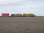 UP 4383 & 9714 rolling east across the open fields