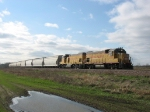 UPY 703 & 740 pulling east under a clearing sky