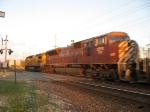 CEFX 117 & UP 9095 streaking east at sunset