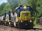 CSX B990 Gets Underway To Work On The Shore