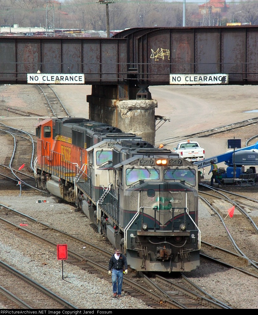 The conductor leads a very dirty, un-patched SD70MAC past work on the Soo Line (Canadian Pacific) bridge over Northtown