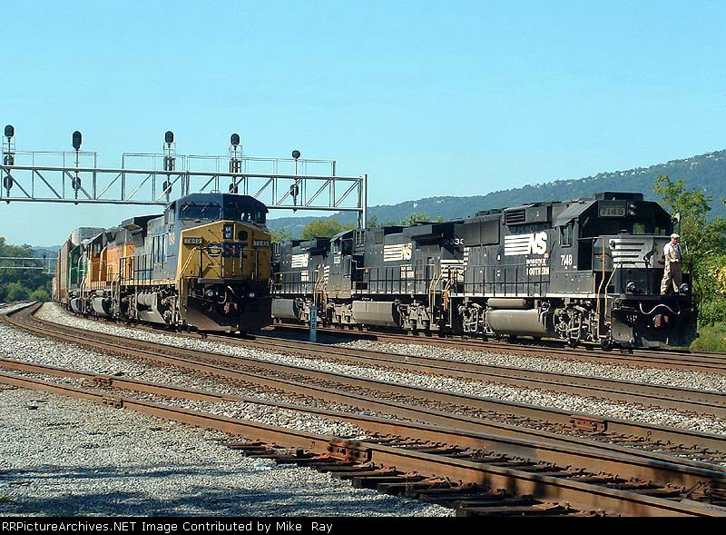 NS and CSX trains pass