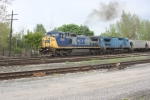 A pair of CSX C40-8Ws handle G384-16 back West through the FRR yard after delivering to the Ethynol plant in Shelby.