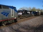 NS 9821 meeting eastbound Amtrak 63