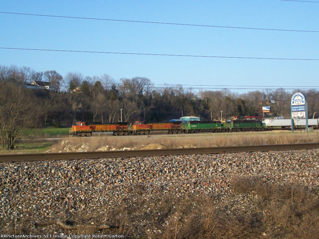 Twin Dash-9Ws and Twin SD40-2s Work to Pull a Piggyback Train Into Town
