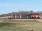 A Four-pack of Illinois Central-marked SD40-2's Head a Long Freight Train on its Way to Chicago