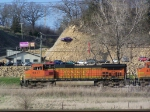 BNSF 5517 Passes a New Car Dealership with a Car Stuck in the Hillside