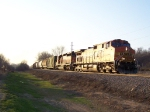 BNSF 4567 Passes Through the Glare of the Fading Sun