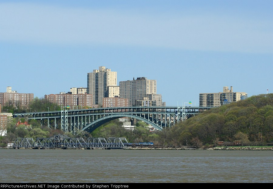 AMTK 714 with NYC's Hickory Creek roll thru Spuytin Duyvil Bridge