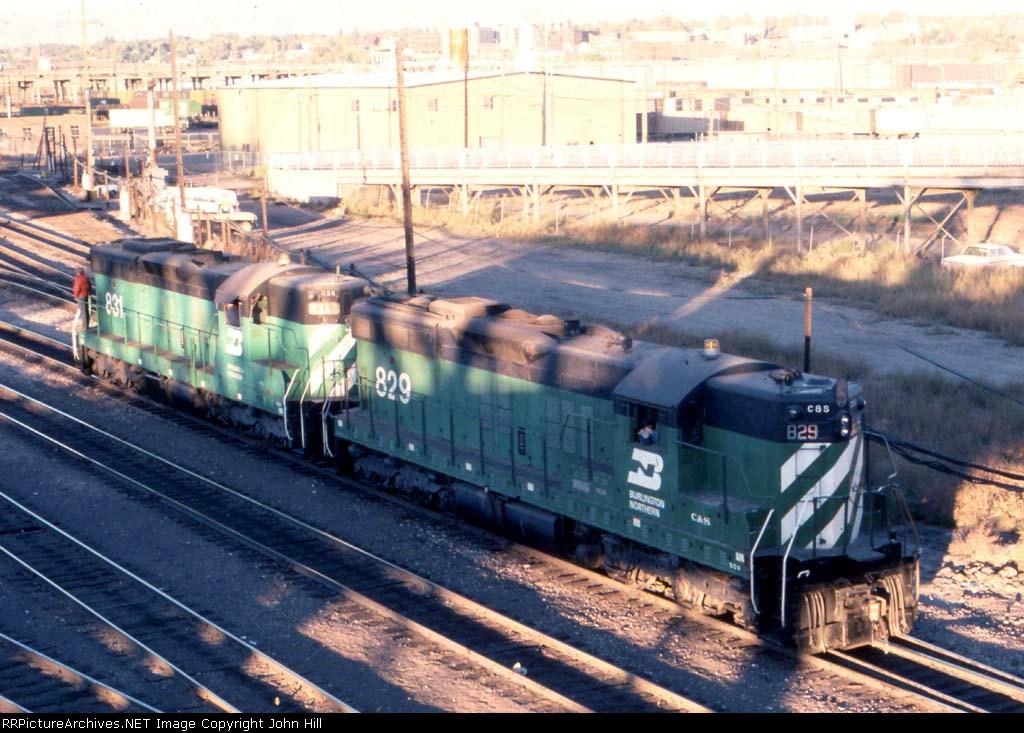 1106-01 CS 829-831 rolls past the depot