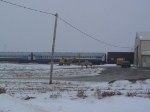 Passenger and Box Cars Usually Seen with the IAIS Steam Power Rest at the IAIS Intermodal Facility
