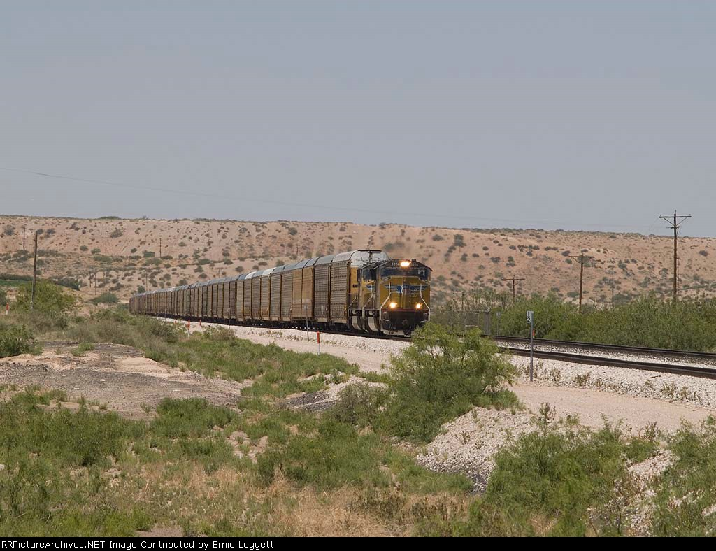UP 5204 leads an EB autorack at 12:38pm