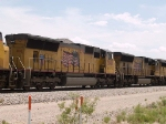 UP 5048 #3 power in an EB intermodal at 12:00