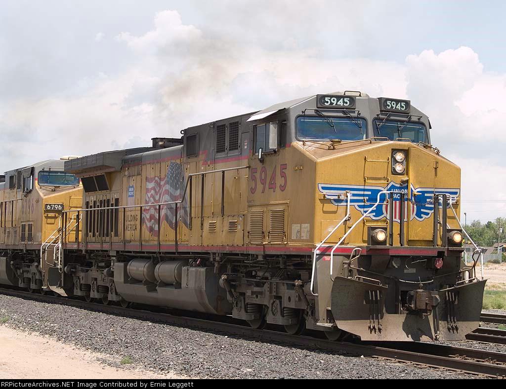 UP 5945 leads an EB grain train at 12:11pm