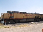 UP 6884 #3 power in EB grain train backing up to connect consist at 11:50am