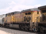 UP 6884 #3 power in an EB grain train at 12:11pm