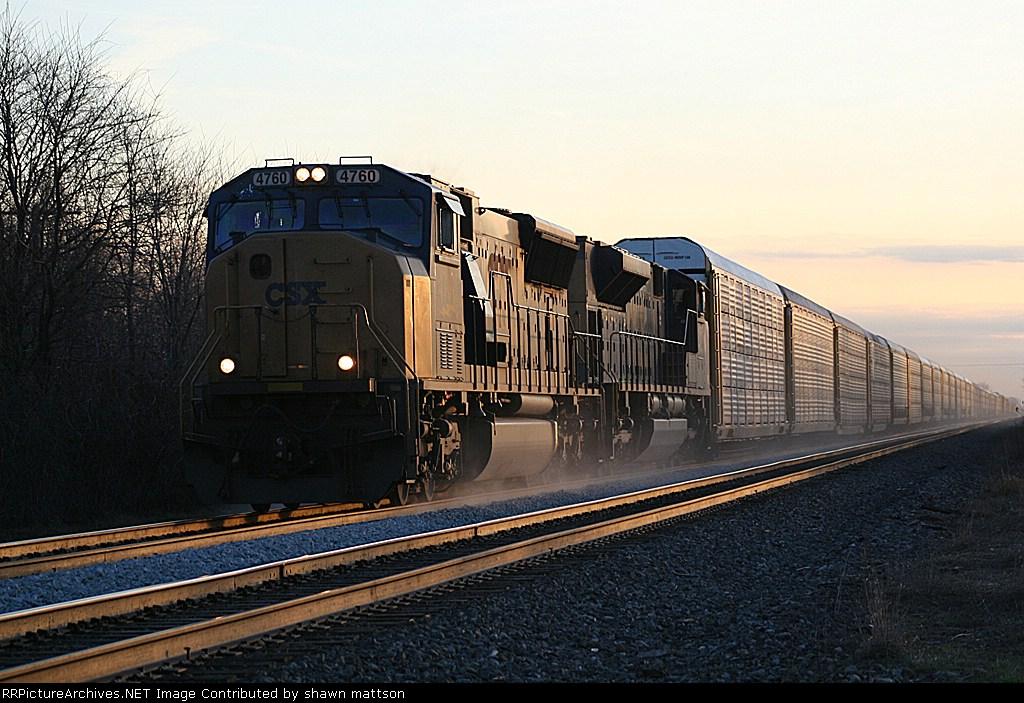 EB autorack at dusk kicken up ballast dust