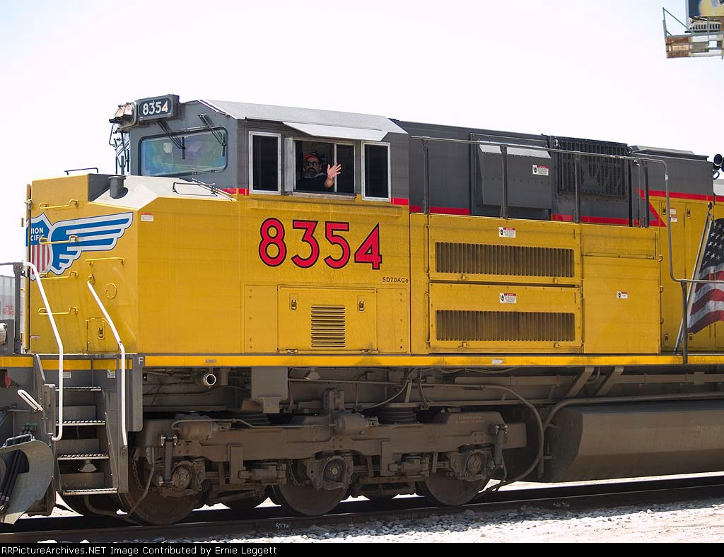 UP 8354 leads an EB manifest at 12:37pm