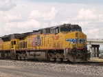 UP 6009 leads a WB empty grain train at 4:39pm