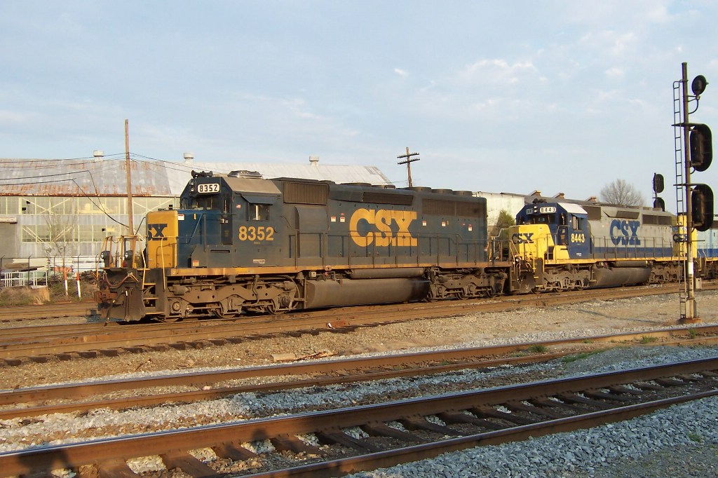 CSX 8352 has spent too much time down on the sandpile of Fl. They outfitted him with twin AC units on the roof