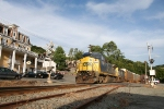 CSX 7364 passes the old Western Hotel