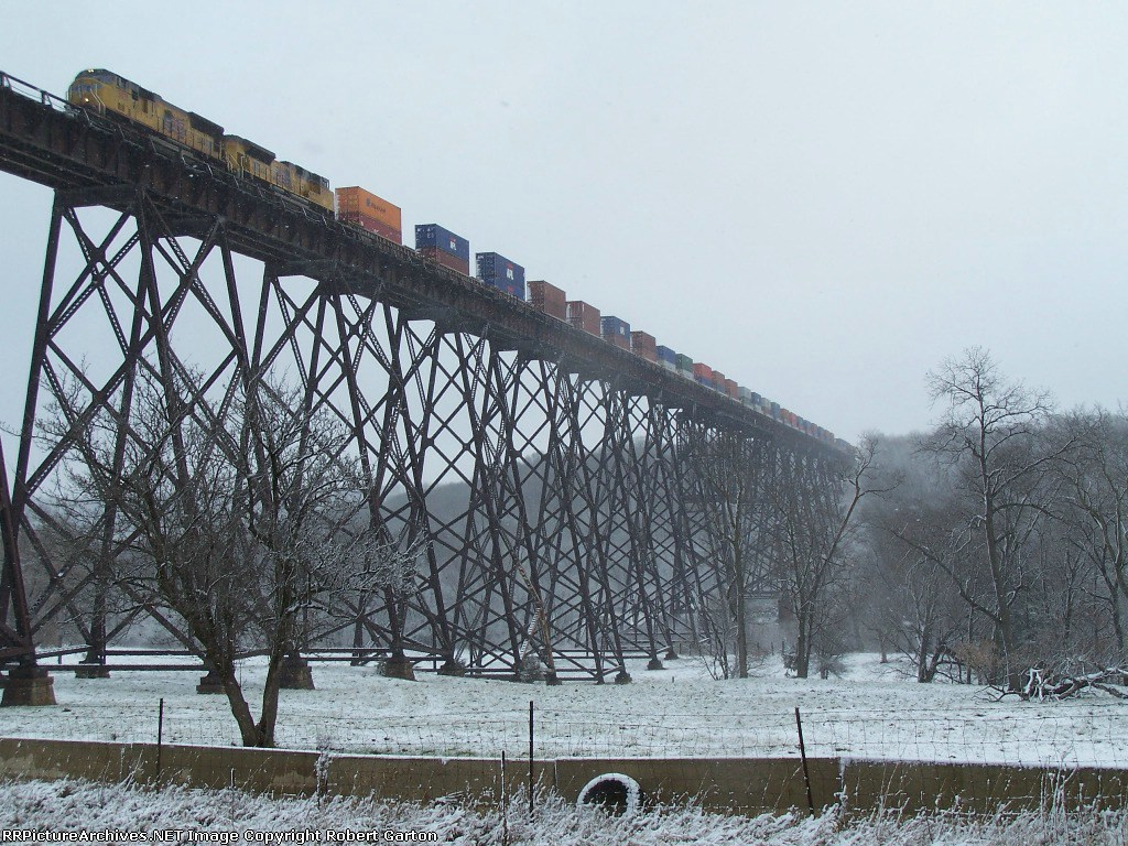 UP 3831 Leads a Doublestack Train Slowly Over the Kate Shelley High Bridge at the end of a Snow Storm
