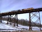UP 6077 Pulls a Coal Train East Over the KSHB