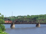 Three Different EMD Locomotives Lead Mixed Freight Across the Mississippi to Illinois