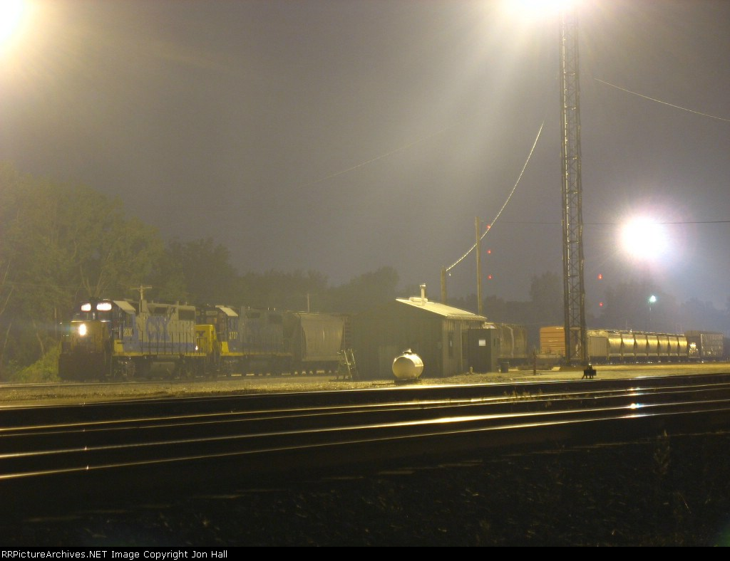 CSX 2630 & 2727 sitting under the yard lights, waiting to go west with Q327-29