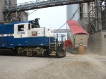 More grain arrives by truck, as its outbound transportation rolls by