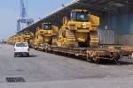 Dockside- Loads of Caterpillars waiting for export