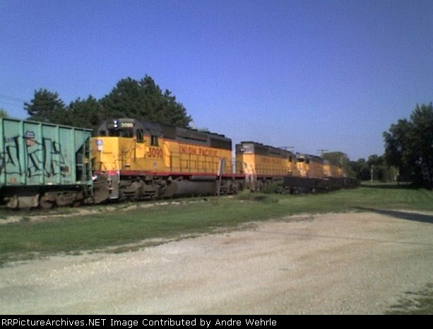 UP 3090 trails on a ballast train from Rock Springs