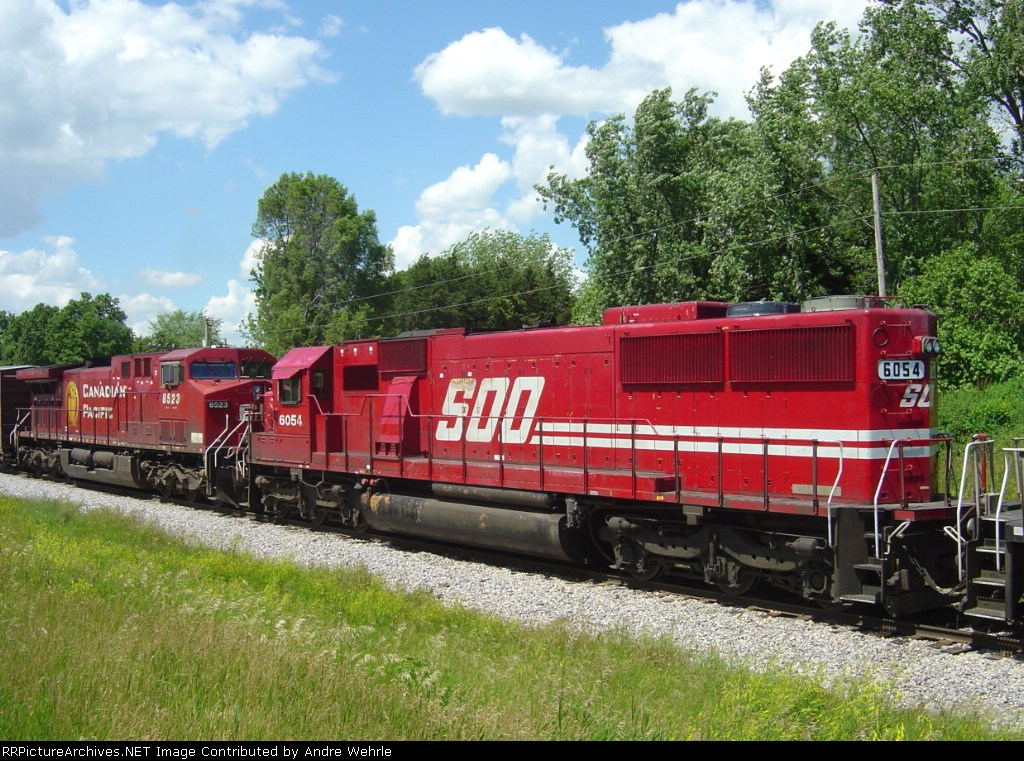 SOO 6054 & CP 8523 round out the colorful 5-unit consist