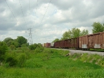 Freight bound for Janesville passing through the bright green Wisconsin spring landscape