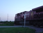 CP 8616 crossing Vincent St. as the sun sets