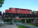 CP 5749 follows 9739 over a swollen Yahara River