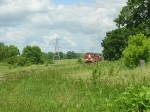 CP 9739 approaches Hammond Rd. through the green countryside