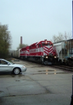 WSOR 4011 leads 4010 and 5 cars to Janesville on a rainy Saturday