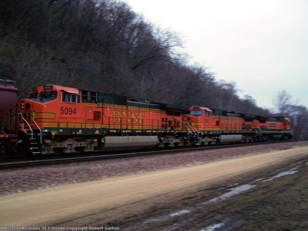 BNSF 5094 Helps Pull a Grain Train Along CN Tracks at Dawn