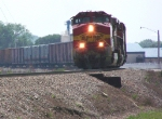 BNSF 762 Rounds a Curve With Boxcars in Tow