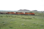 BNSF 8225 leads a set of three SD75M's west by the Camel Hump Hills