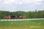 CN 8002 and CN 2445 heading east
