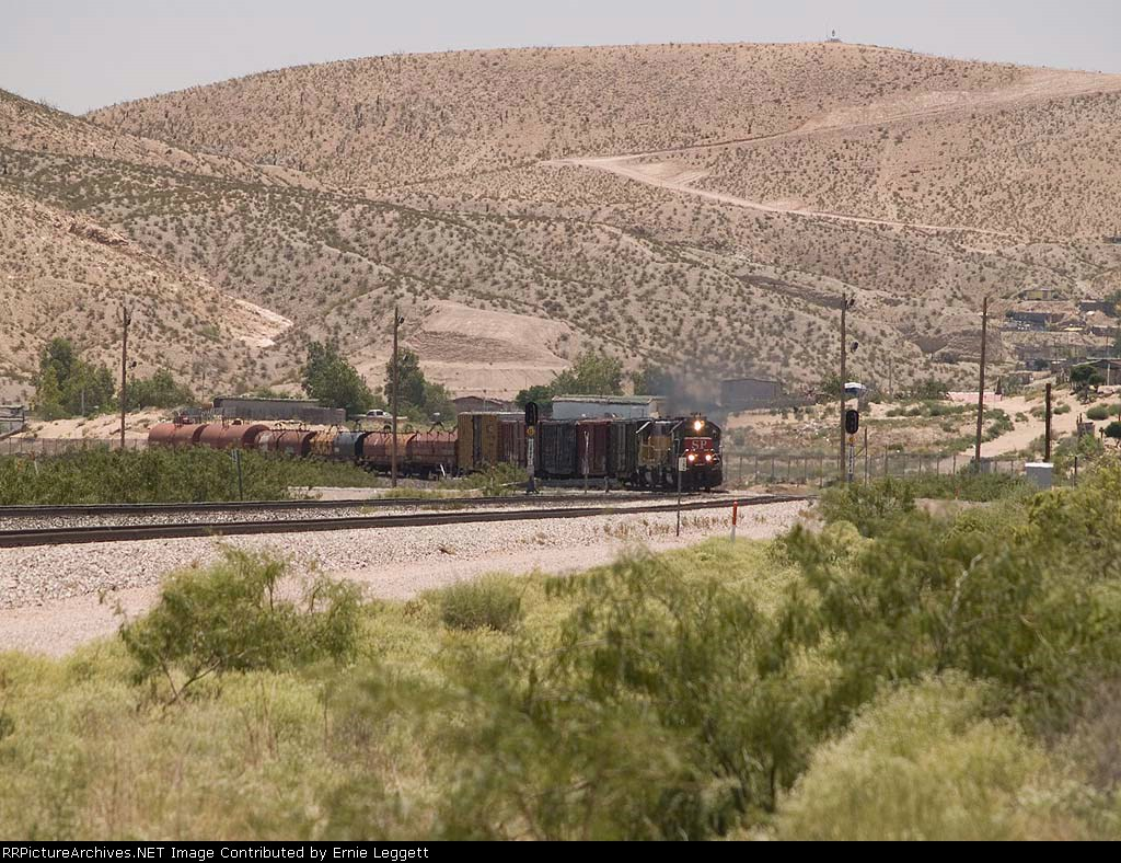 SP 7100 leads a WB local manifest at 12:17pm