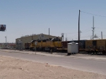 UP 1946 and UP 2016 back a manifest past the Carrizozo switch at 12:15pm
