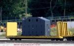 P+H Harnischfeger component rides a company bulkhead flat