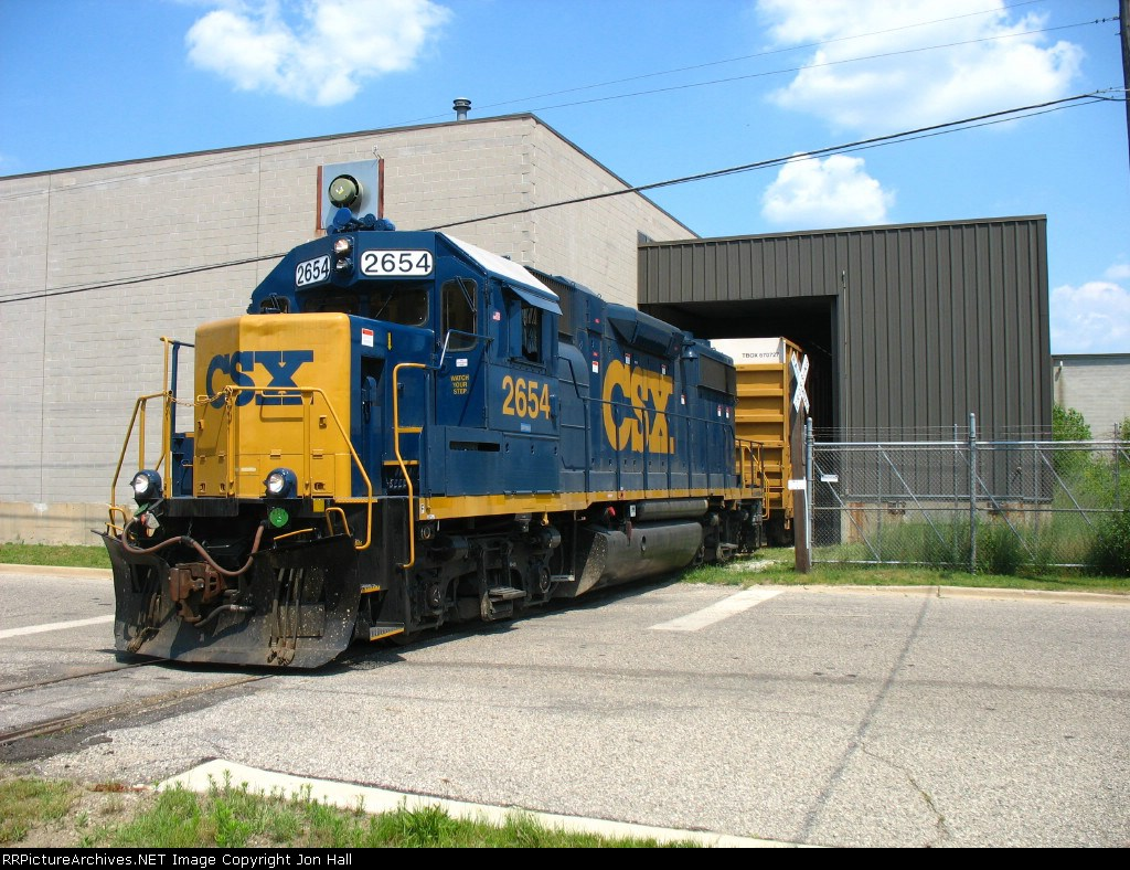 2654 backing into the building at Haviland Chemicals