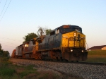 CSX 7797 & 7627 rolling west in the last rays of light with Q335-09