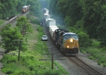 CSX 5418 East Passes a Recrewing Autorack Train As the Sun Begins to Work its Way into Frenchs Hollow