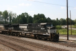 NS 9007 (Dash9-40CW) leads off heading south with a stacktrain